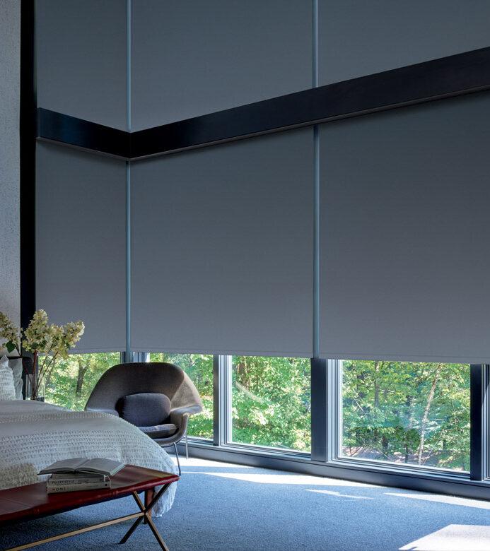 room darkening roller shades on floor to ceiling bedroom windows in Fort Myers FL