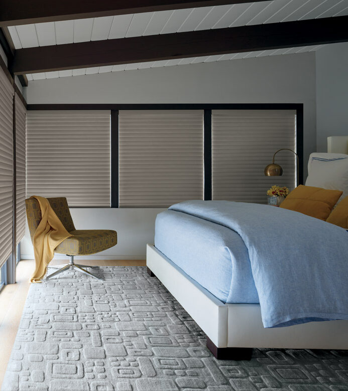 master bedroom with wall to wall windows covered with room darkening blinds in Naples FL