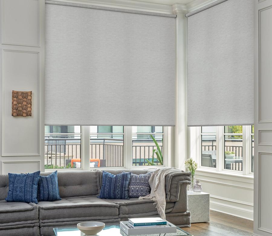 living room large corner window with designer roller shades in Naples FL
