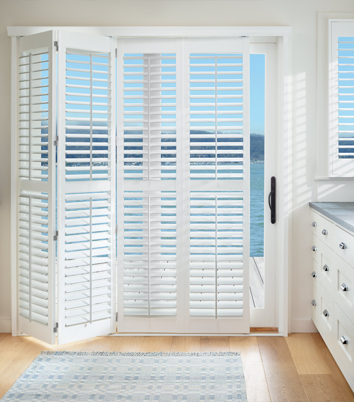 white shutters bi-fold for sliding glass door window treatments in Naples FL
