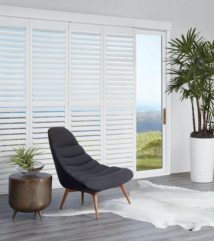 white sliding plantation shutters for glass doors in Naples FL