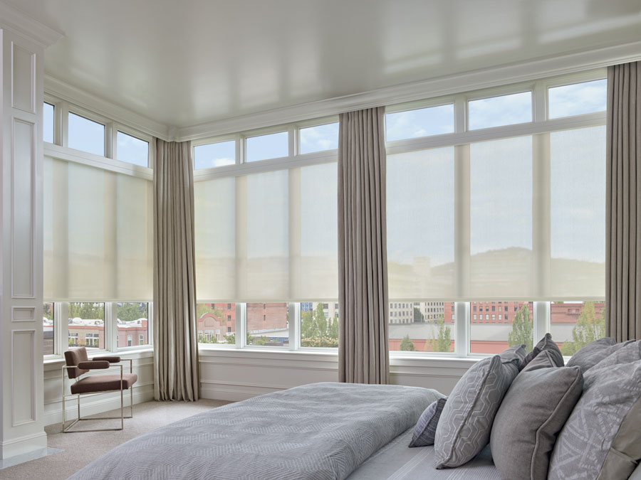 Largest windows with designer screen shades in bedroom of ft Myers home