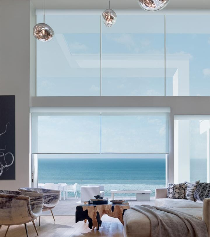 wall of windows with floor to ceiling shades in Fort Myers FL