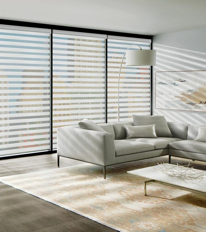 condo wall of windows with designer banded shades for large windows in Naples FL