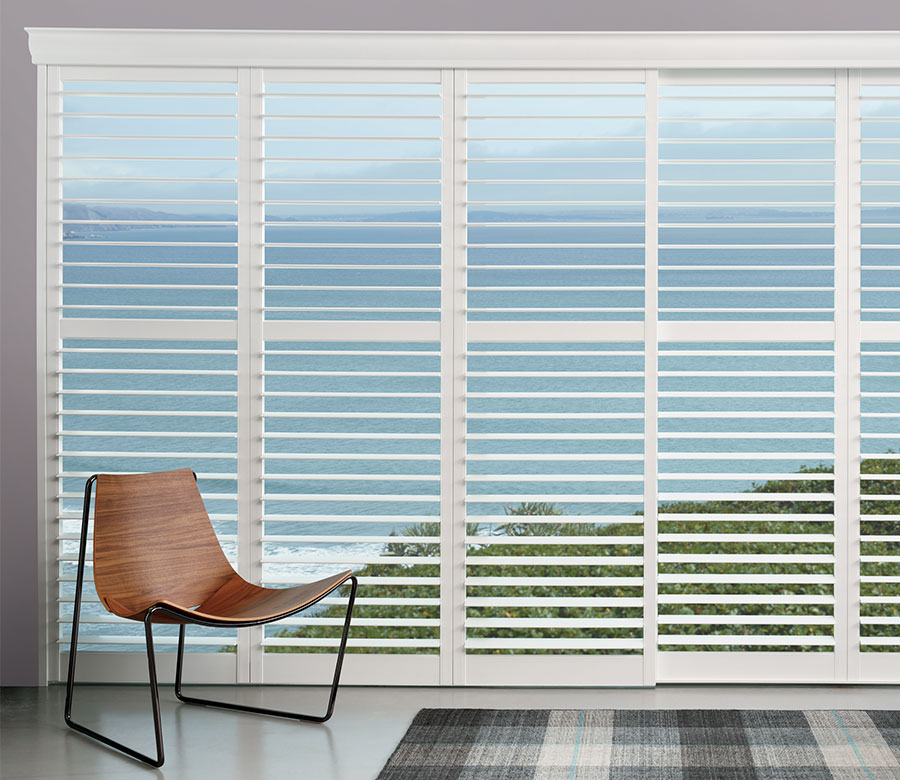 Shutters on floor to ceiling windows with landscape view in Naples Florida