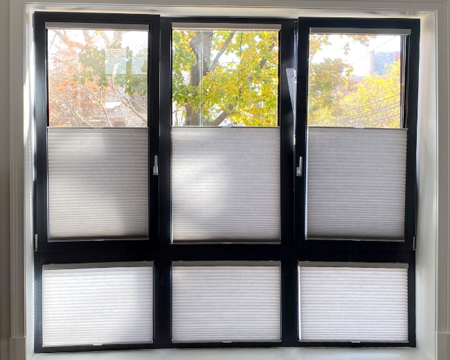 black framed tilt turn window with cellular shades in Fort Myers FL