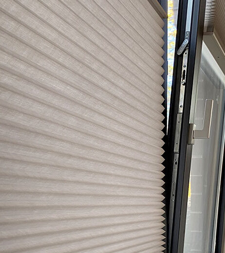 gray cellular shades with trackglide on european style windows in Fort Myers FL