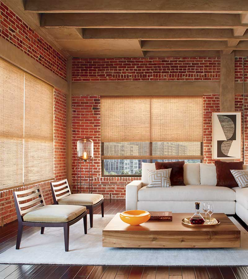 exposed brick loft with woven wooden window shades in Fort Myers 33908