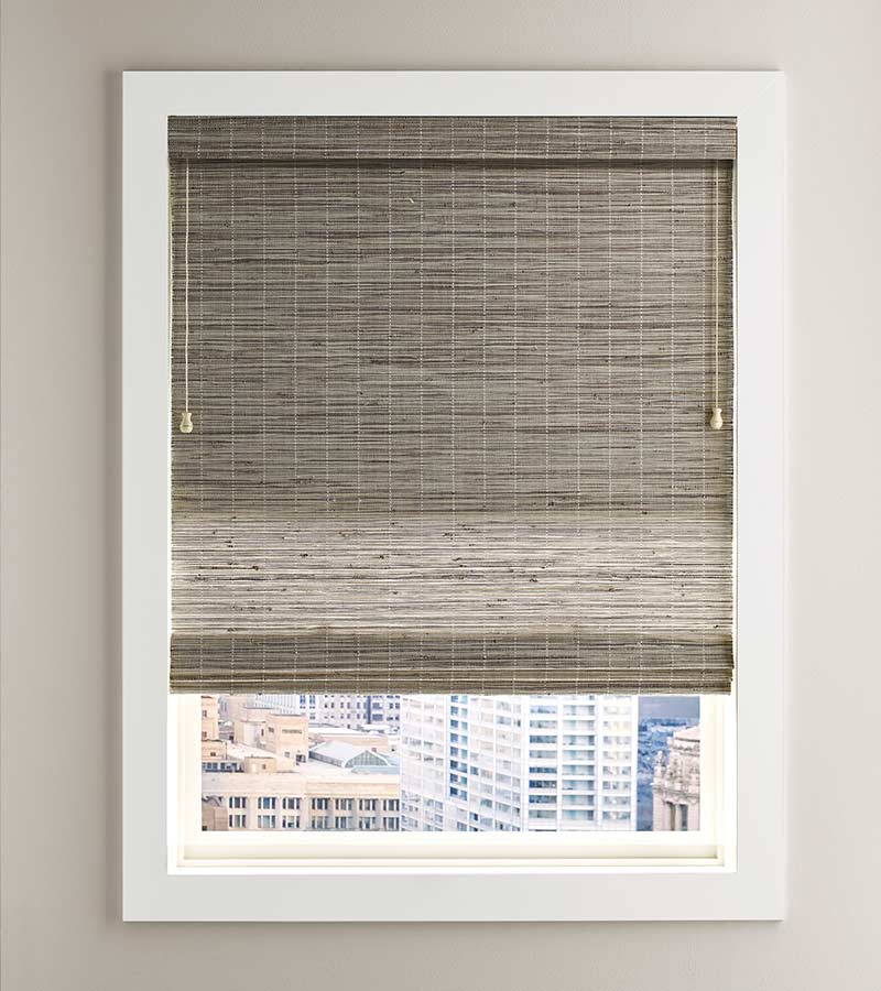 white framed window overlooking city with fabric shade in Fort Myers 33908