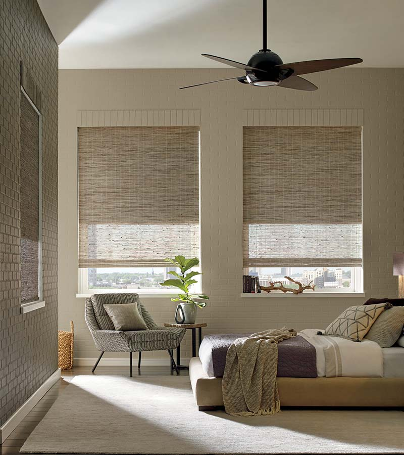 beige bedroom with woven wood shades