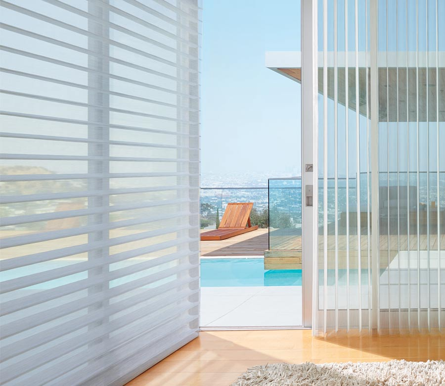 beachy home with floor to ceiling luminette privacy sheers overlooking outdoor pool