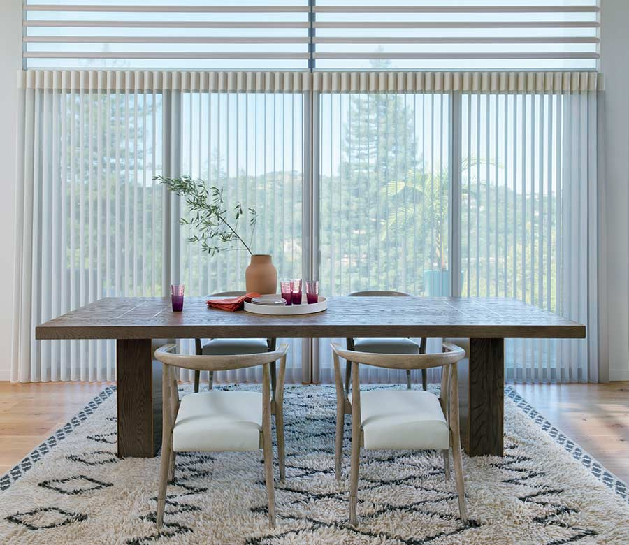 Modern dining room with floor to ceiling luminette privacy sheers in Naples 34119