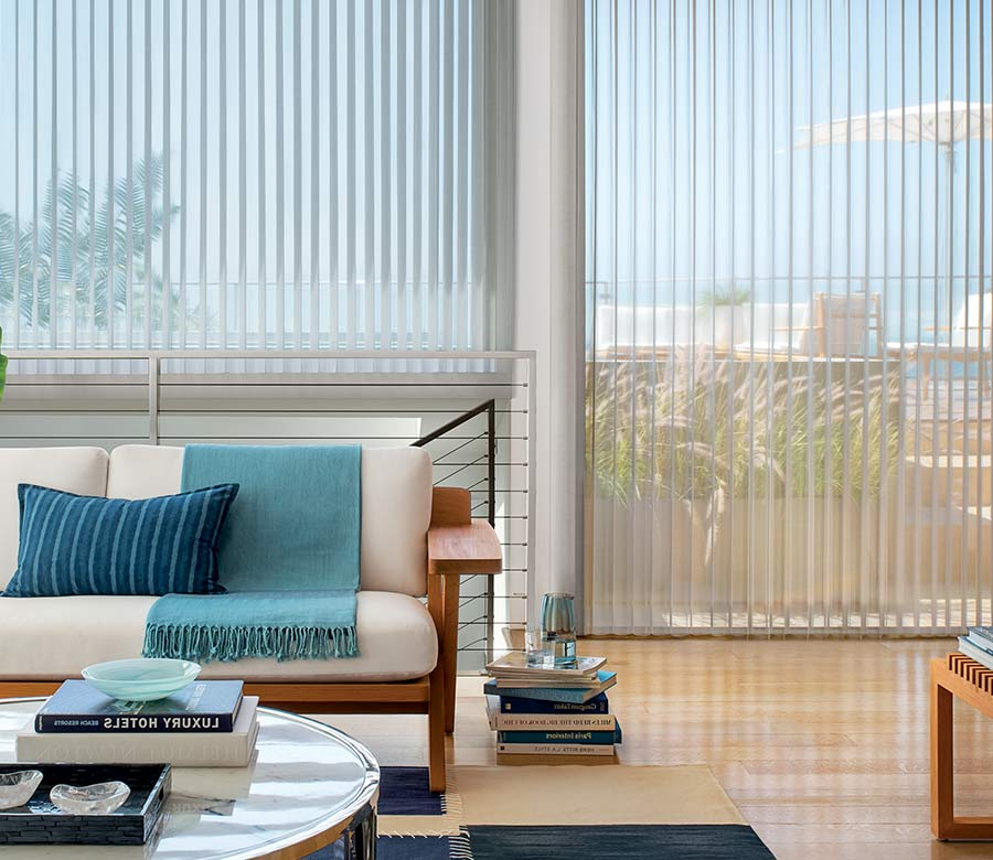 coastal inspired living room floor to ceiling gray window shadings and blue accents in Vineyards, 34119