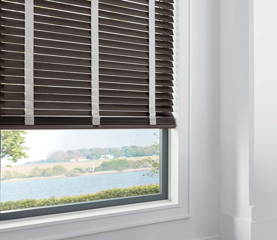 brown wood blinds overlooking the river
