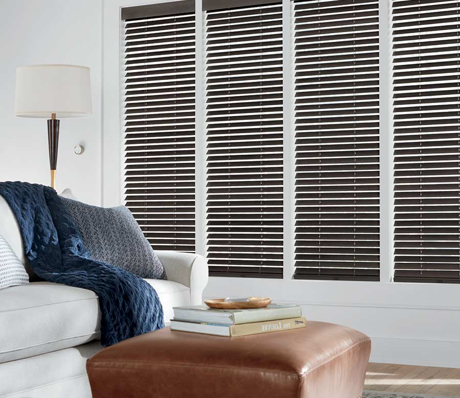 white living room with brown wood blinds