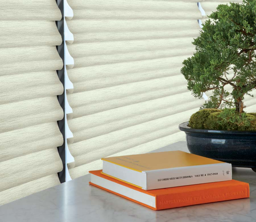table with orange books and hunter douglas roman shades Fort Myers