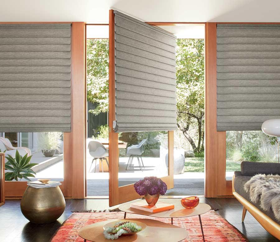 boho living room with vignette modern roman shades on sliding glass doors Naples
