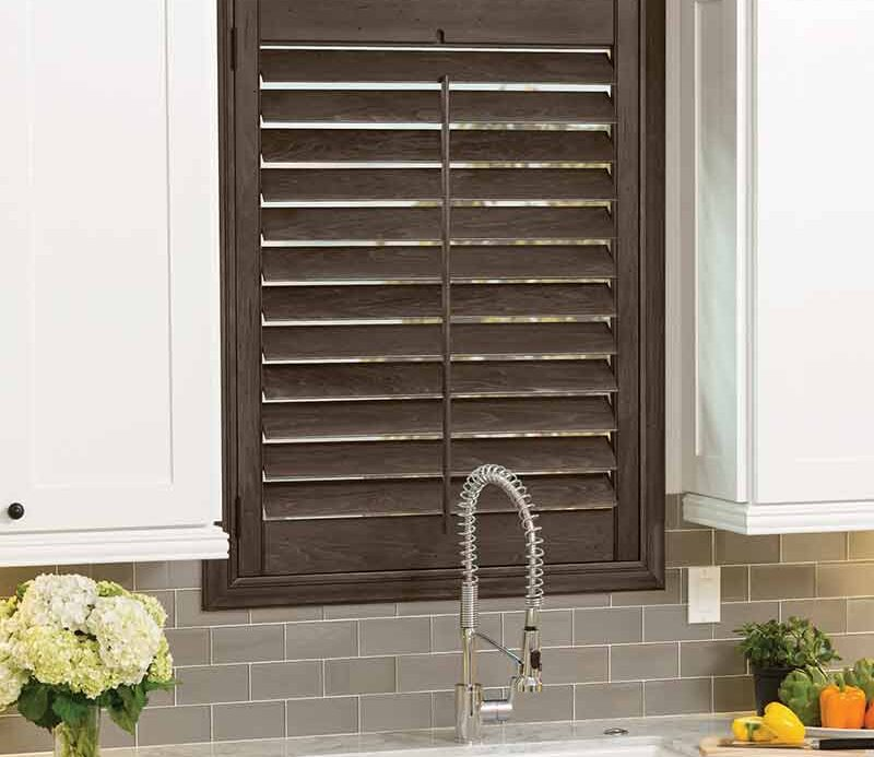 dark kitchen shutters behind sink in Naples, FL