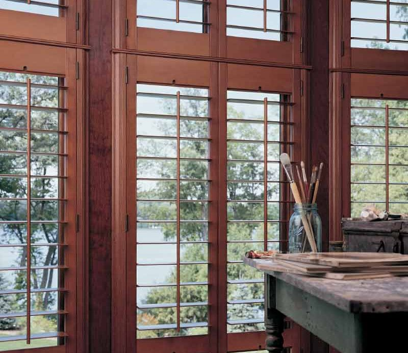 cherry stained wood shutters in artist studio in Fort Myers, FL