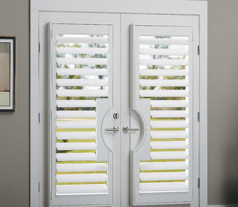 room darkening shutters on glass patio doors in master bedroom Punta Rassa, FL