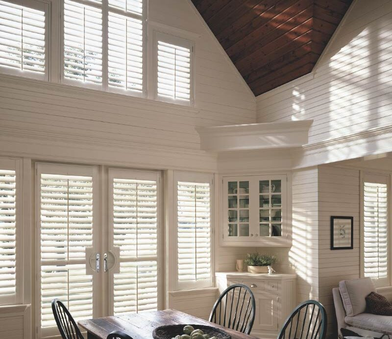 white shutters for renovated farmhouse in arched and angled windows in Fort Myers, FL