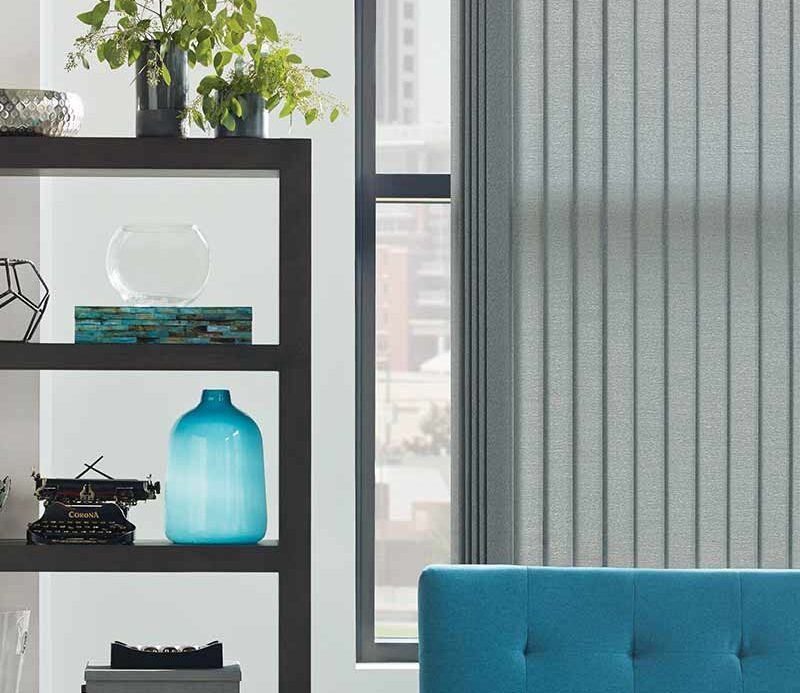 Fort Myers, FL apartment with gray vertical window blinds for large windows